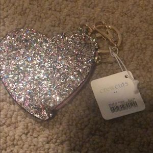 J crew heart shaped coin purse.  Crew cuts
